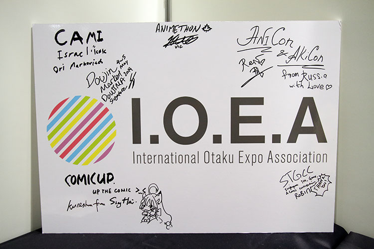 Close up of IOEA signboard with signatures of representatives from various conventions around the world.